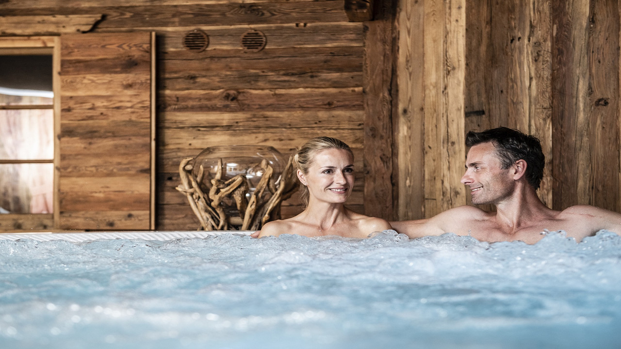 Couple in the whirlpool Mirabell Dolomites Hotel Valdaora