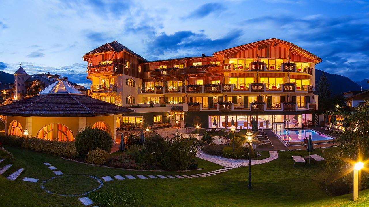 Summer exterior in the evening Mirabell Dolomites Hotel Valdaora