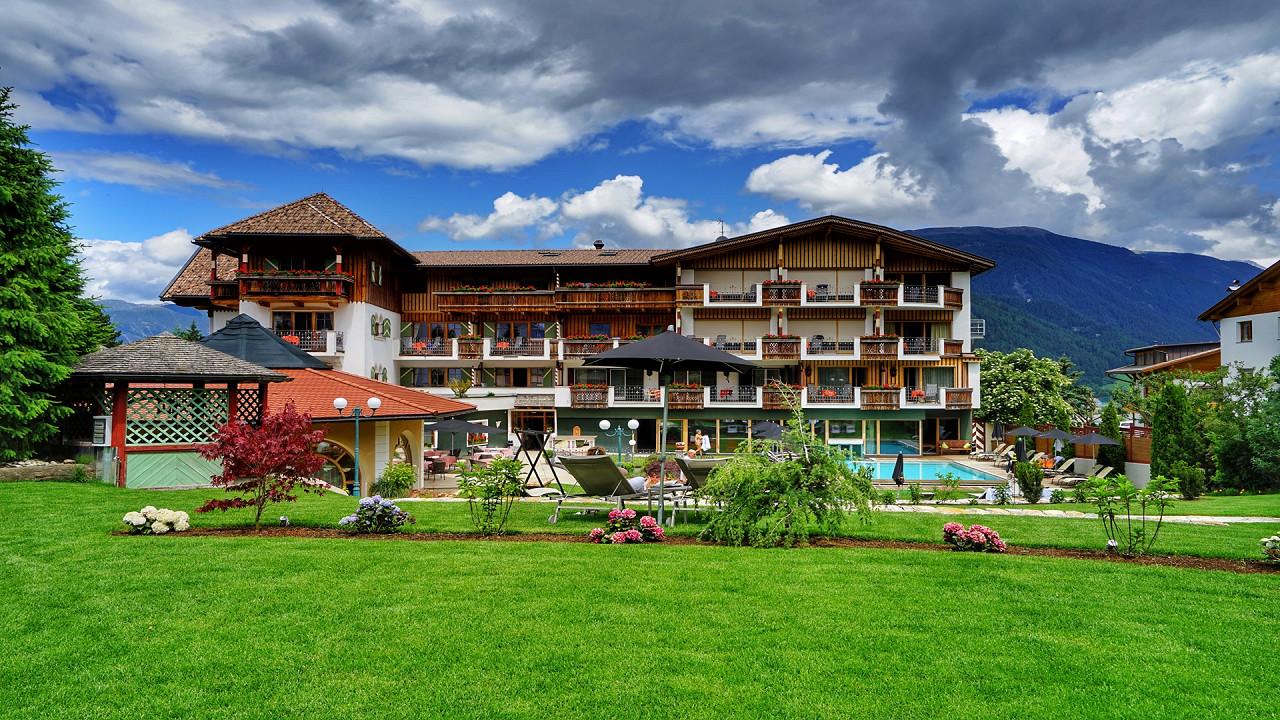 Summer exterior with garden Mirabell Dolomites Hotel Valdaora