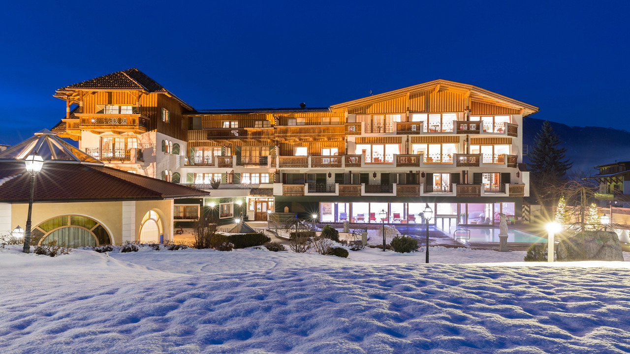 Winter exterior in the evening Mirabell Dolomites Hotel Valdaora