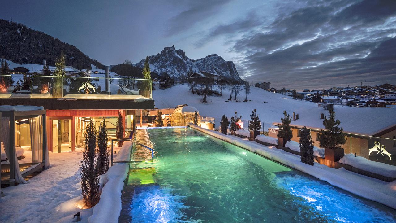 Swimming pool in winter Abinea Dolomites Romantic Spa Hotel Castelrotto