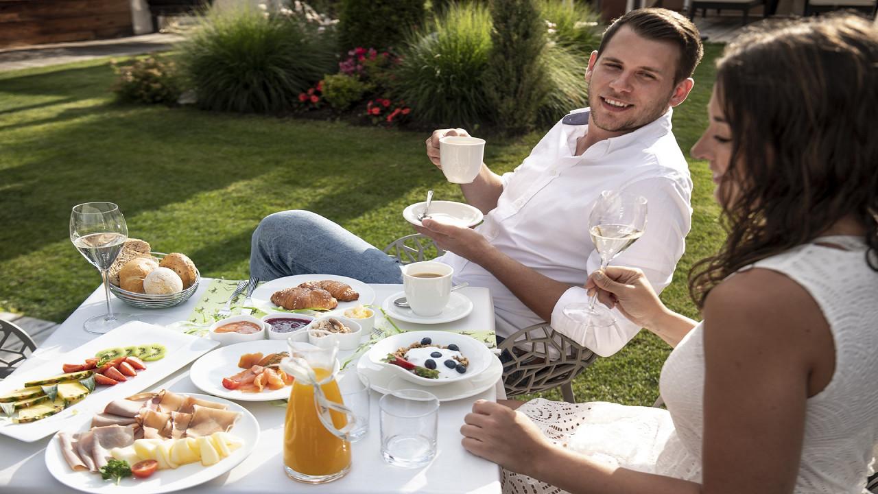 Couple having breakfast Abinea Hotel Castelrotto