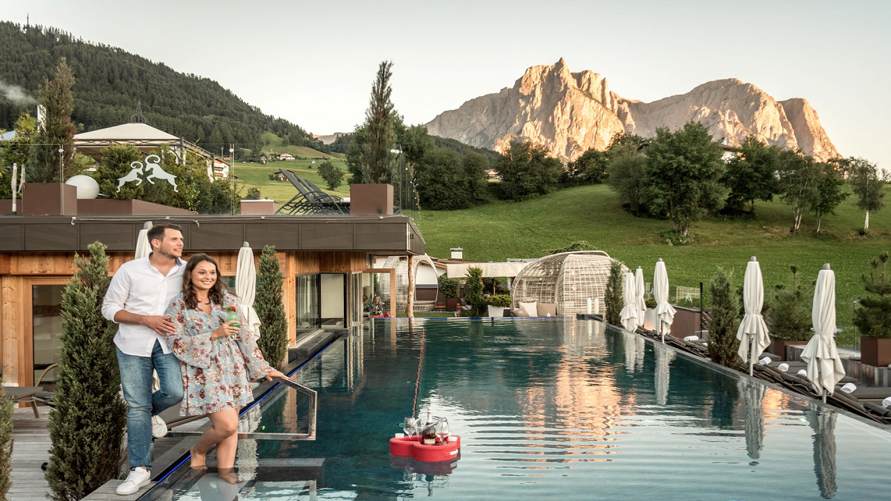 Pair along the edges of the Infinity Pool Abinea Hotel Castelrotto