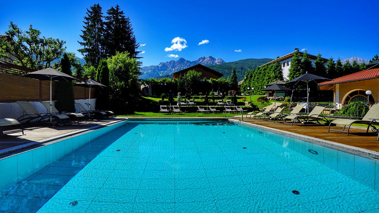 Outdoor pool Mirabell Dolomites Hotel Valdaora