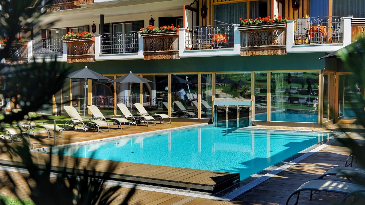 Pool in the garden Mirabell Dolomites Hotel Valdaora