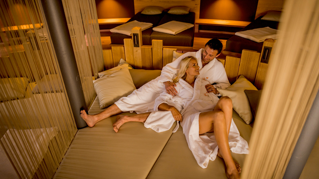 Couple in the relaxation room Mirabell Dolomites Hotel Valdaora