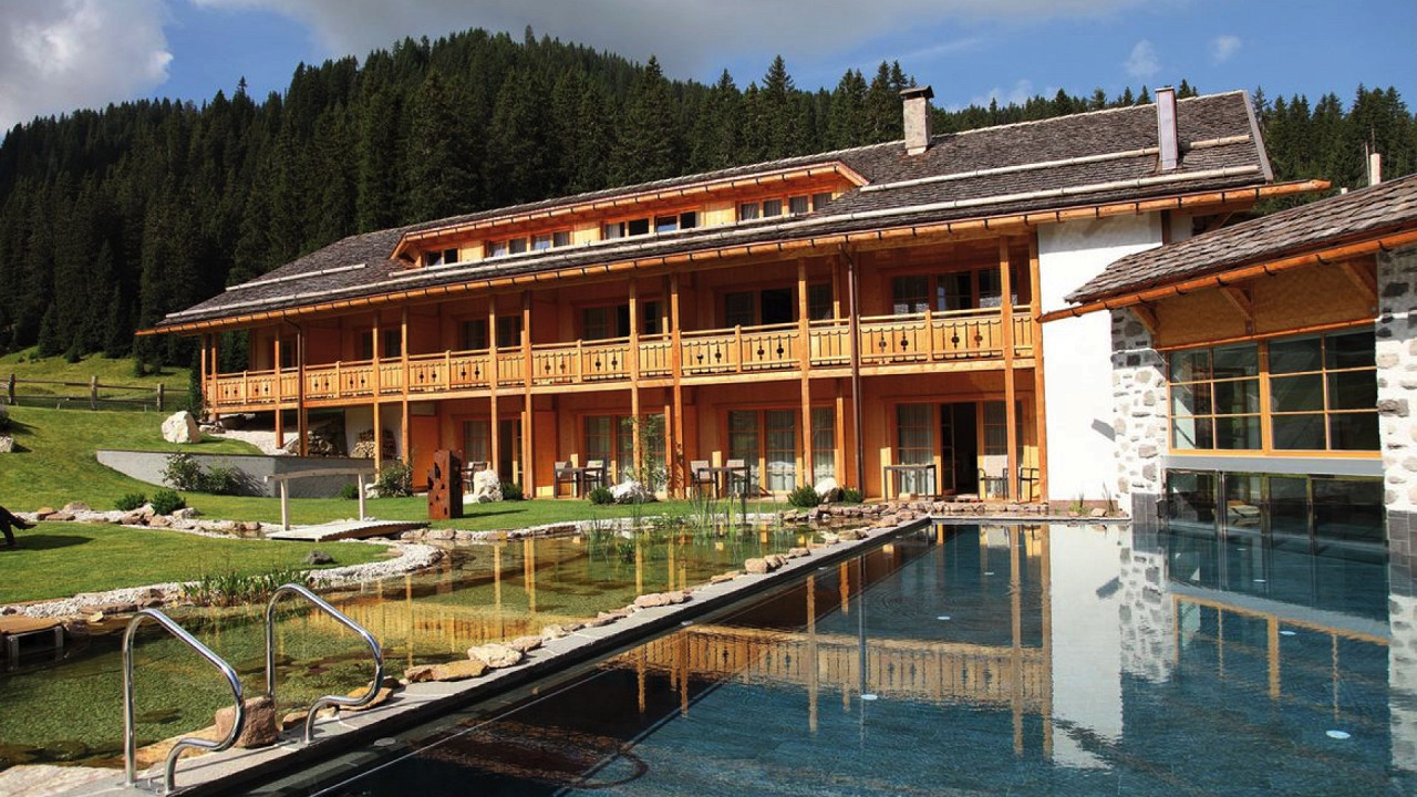 Summer outside with pool and pond Tirler Hotel Alpe di Siusi