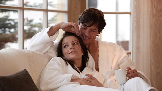 Pair in bathrobe Adler Lodge Alpe di Siusi romantic
